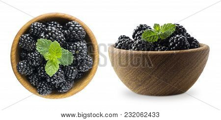 Blackberries In A Wooden Bowl With Copy Space For Text. Ripe And Tasty Black Berry Isolated On White