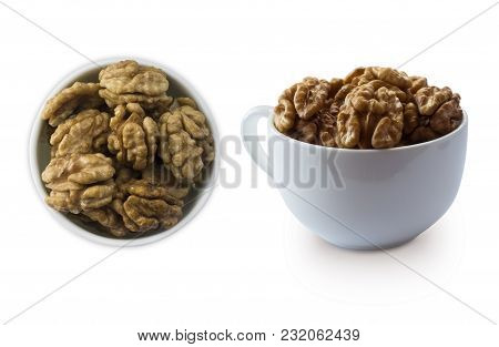 Kernels Walnuts Isolated On White. Walnuts In A Bowl Isolated On White Background. Walnuts With Copy