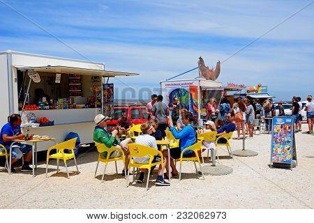 Sagres, Portugal - June 9, 2017 - Tourists Relaxing At Snack Stalls, Cape St Vincent, Sagres, Algarv