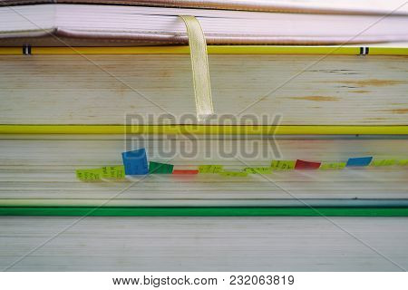 Stack Of Book On Blurred Natural Green Background With Soft Tone Effect For Knowledge And Education