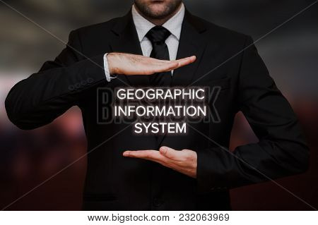 Geographic Information System (gis) Concept Text Between Hands Of The Businessman, Blurry Bokeh Back