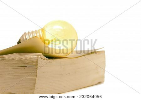 Old Book With Glowing Light Bulb On White Background For Ideas To Solve Solutions In Learning And Ed