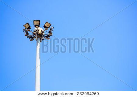 Street Lighting Or Spotlight Lamp Against Blue Sky Background For Light Up At Night