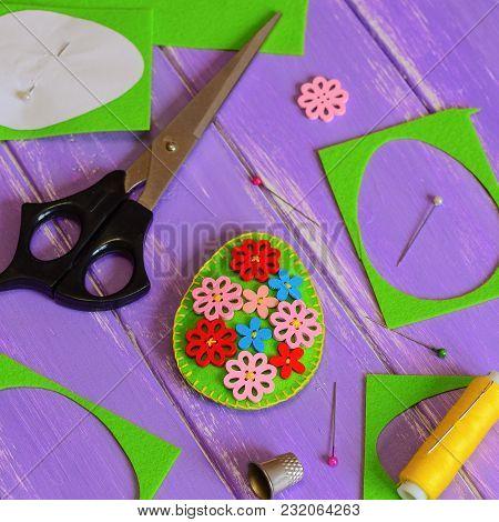 Felt Easter Egg Decoration Idea. Hodemade Felt Easter Egg With Colored Wooden Flower Buttons. Felt S