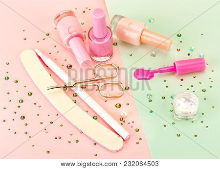 Manicure Accessories And Nail Polish On A Colored Background.