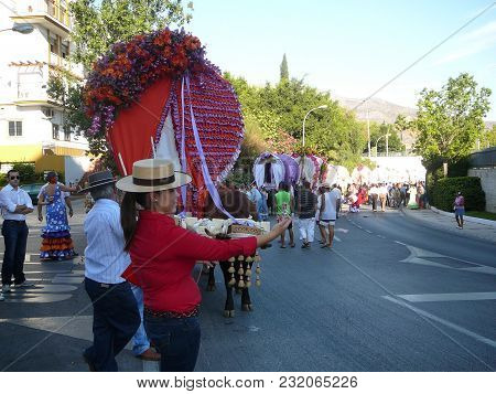 Alora, Spain - September 25, 2011: Woman Taking Selfie At Local Fiesta In Andalusia