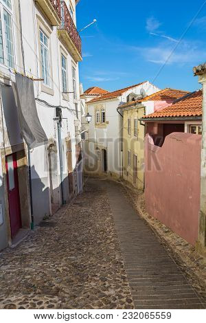 Coimbra, Portugal - August 2016: Old Narrow Street In Portuguese Town Of Coimbra.