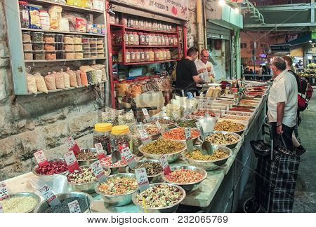 Jerusalem, Israel, September 10, 2015 :  The Seller In The Open Shop Weighs The Spice Buyer In The M