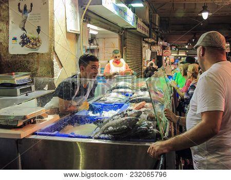 Jerusalem, Israel, September 10, 2015 :  Buyers Buy Fresh Fish In The Open Store In Mahane Yehuda Ma