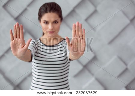 Stop Injustice. Nice Pleasant Young Woman Looking At You And Holding Her Hands In Front Of Her While