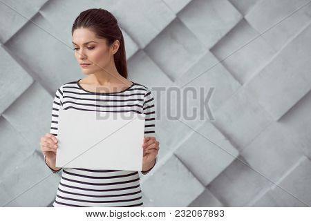 Stop Harassment. Nice Pleasant Sad Woman Standing Against The Wall And Looking Aside While Showing Y