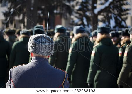 Russian Winter. Parade. A Soldier With A Bayonet In A Astrakhan Cap