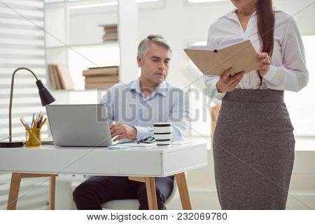 Sexual Object. Selective Focus Of An Attractive Woman Standing In The Office And Reading The Book Wh