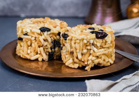 Eastern Or Asian Sweets (chak-chak) With Honey, Raisins And Walnut On Stone Concrete Table Backgroun