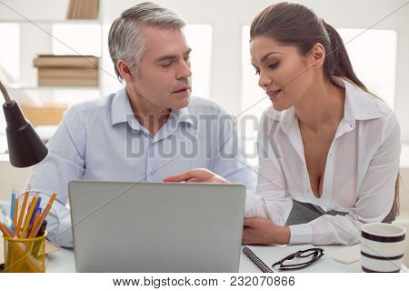 Inappropriate Interest. Pleasant Attractive Young Woman Sitting Together With Her Male Colleague And
