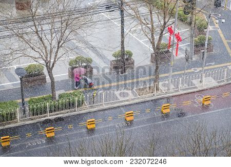Rare Snowy Day In Chaoyang District Beijing, China In March 17,2018. Unrecognizable Person Under Umb