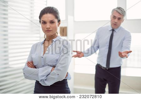 I Am Not Afraid. Smart Confident Nice Woman Standing Cross Handed And Looking At You While Being At