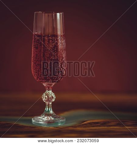 Alcohol Drinks (sparkling Wine) On Dark Solid Red Background