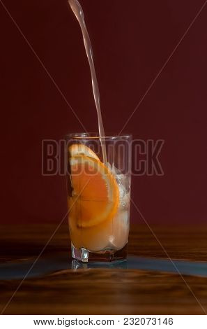 Alcohol Drinks ( Grapefruit Cocktail) On Dark Solid Red Background