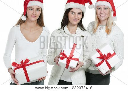 Group Of Female Students In Costume Of Santa Claus With Christmas Gifts .photo With Copy Space.