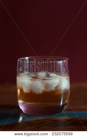 Alcohol Drinks (red Wine, Whisky, Grapefruit Cocktail) On Dark Solid Red Background