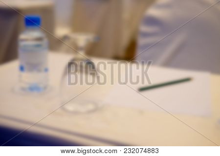 Blur Background Of Pencil And Glass For Drink On The Table In The Seminar Or Conference Hall Room. B
