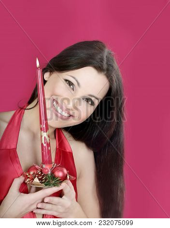 Closeup . A Young Woman With A Christmas Candle.photo With Copy Space