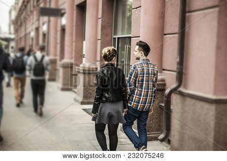 Concept Of Happiness. Rear View. Loving Couple On A Walk