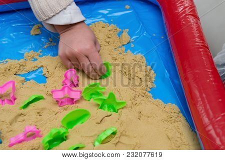 Kid Playing Sand And Plastic Moulds Horizontal