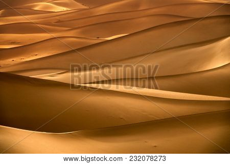 Background with beautiful structures of sandy dunes in the Sahara desert