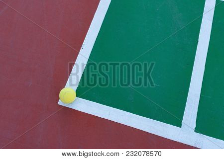 Tennis Ball On The Corner Of A Hard Court