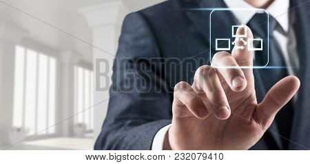Businessman Touches Virtual Communication Icon Of Social Network In Bright White Office.