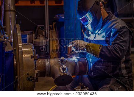 Welder At Orbital Welding Machine, Pipe Stopped