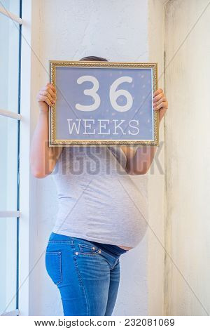 36 Weeks Of Pregnancy, Sign With Text In Woman Arms