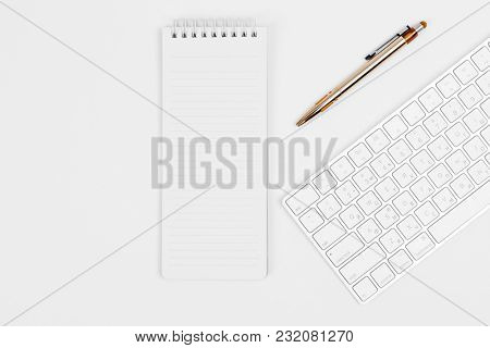 the white open notepad and computer keypad isolated on the white background