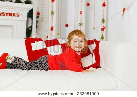 Little Baby Girl In Beautiful Christmas Decorations. New Year Preparation.