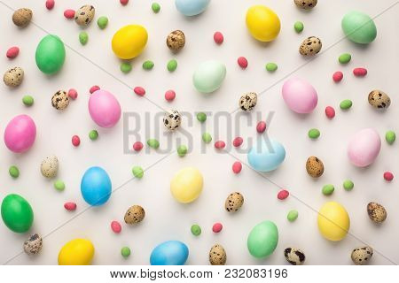 Gradient Colored Easter Chicken Eggs And Natural Quail Eggs On White Isolated Background. Top View O