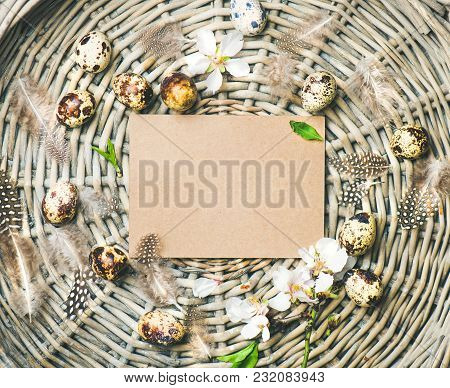 Easter Holiday Background. Flat-lay Of Natural Colored Quail Eggs, Tender Almond Blossom Flowers, Fe