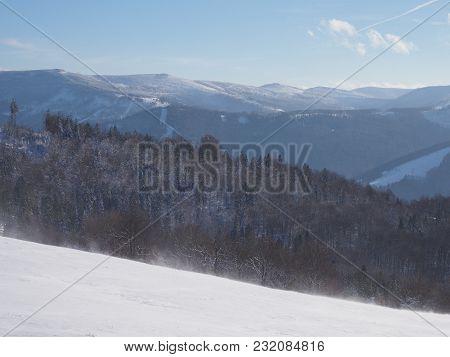 Scenic View Of Snowy Beskid Mountains Range Landscapes Seen From Blatnia Mount Near City Of Bielsko-