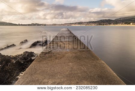 Old Fishermans Pier At South End Of Praia America, Nigrán, Galicia (spain). Long Exposure Daylight S