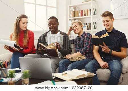Multiethnic University Students Studying Together. Young People Working With Tests And Gadgets, Sitt