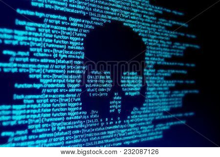 Computer Code On A Screen With A Skull Representing A Computer Virus / Malware Attack.