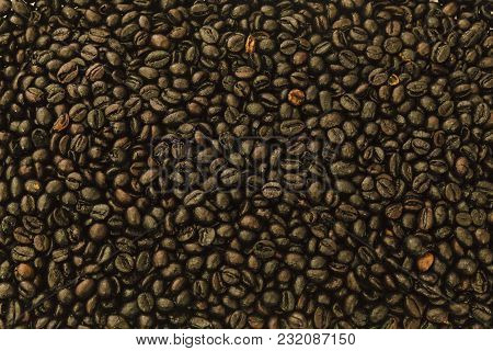 Background Of A Group Of Dark Brown Roasted Coffee Beans