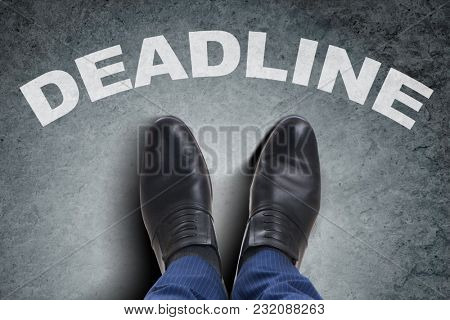 Businessman feet facing tough deadline