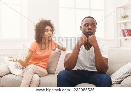 Young African-american Couple Quarreling At Home, Man Offended. Family Relationship Difficulties Con