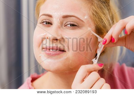 Facial Dry Skin And Body Care, Complexion Treatment At Home Concept. Woman Removing Gel Peel Off Mas