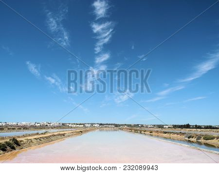 Saline In Southern Spain With A Fantastic Blue Sky. The Salt Fields Are Created For Salt Production