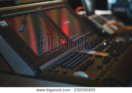 Sound Engineer During Work, A Person Manages The Equipment During The Event. Sound Design Of A Large