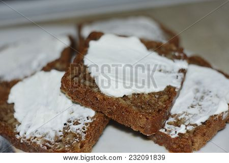 Slices Of Bread Smeared With White Cheese