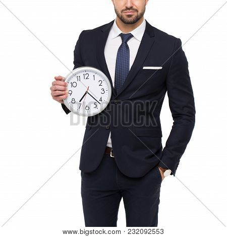 Young Stylishg Businessman Concept In Formal Wear Holding Clock, Isolated On White